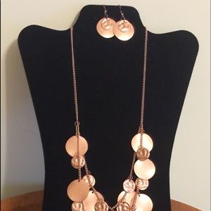 Copper tone necklace and earrings set.